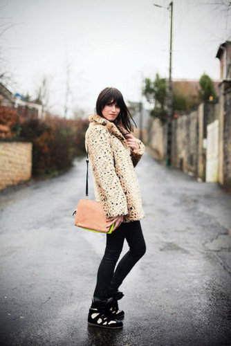Who knew leopard went so well with sporty kicks? This sneaker and coat combo is your proof. Source: Lookbook.nu
