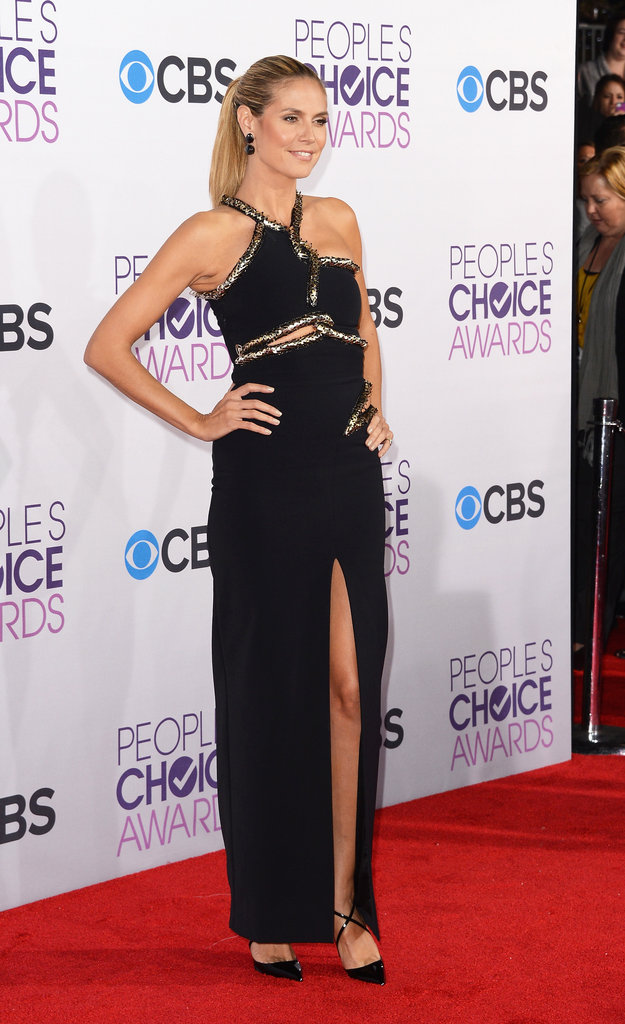 Heidi Klum showed off her legs in a black gown with a high slit.