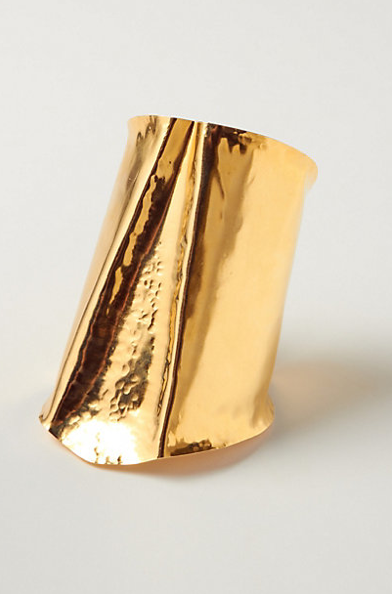 Wear this Anthropologie hammer split brass cuff ($128) over a black turtleneck sweater dress for a look that's perfect for the office or a weekend outing.