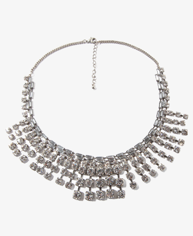 Forever 21's graduated rhinestone necklace ($18) is a deceptively affordable option; add a little dazzle to your office look and wear it over a collared blouse.