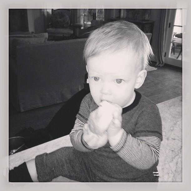 Lil Luca Comrie looked perfectly content eating a croissant at home. Source: Twitter user HilaryDuff