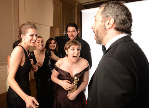 The cast of Girls showed their winning excitement with Judd Apatow in the press room.