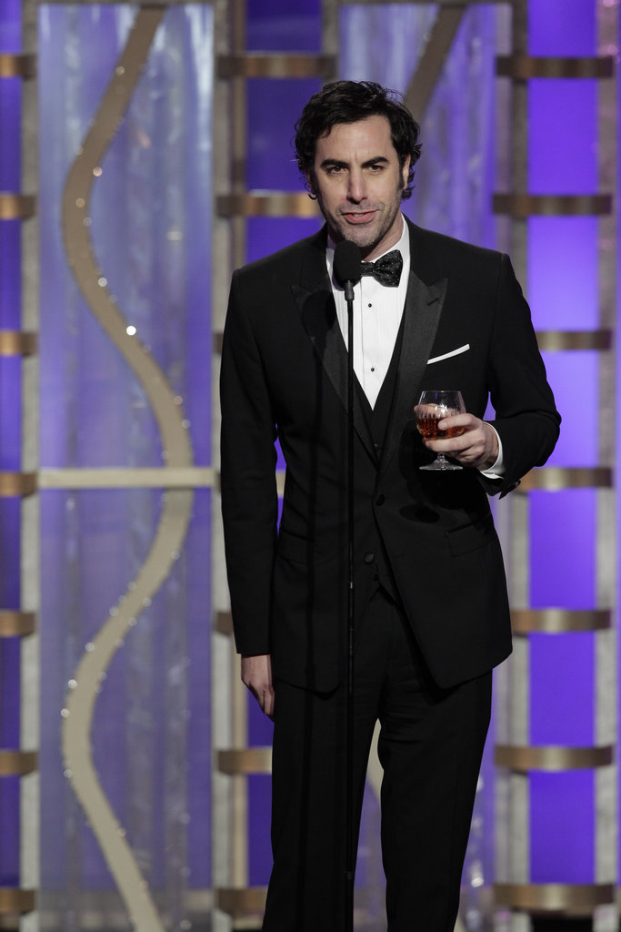 Sacha Baron Cohen joked about Anne Hathaway's upskirt moment.