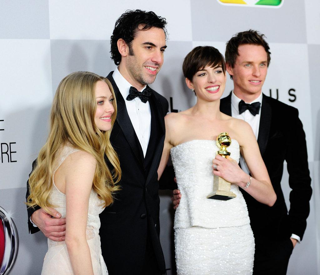 Amanda Seyfried, Sacha Baron Cohen, Eddie Redmayne and Anne Hathaway got together for a photo.