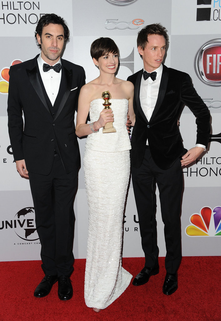 Anne Hathaway got together with Sacha Baron Cohen and Eddie Redmayne at the NBC after party.