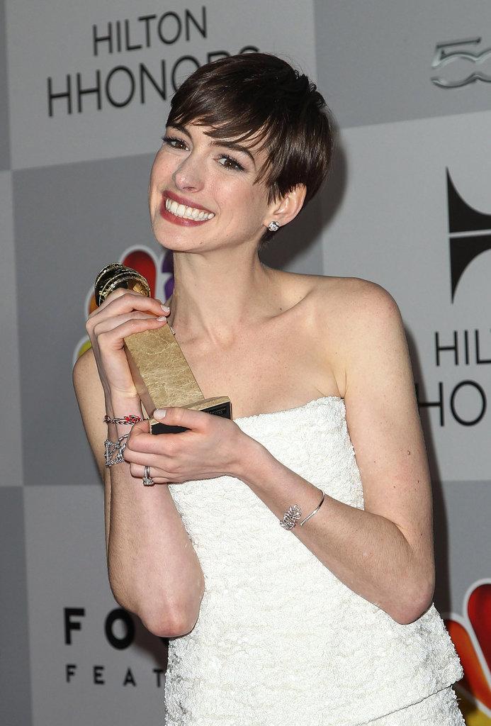 Anne Hathaway got giddy with her Golden Globe award.
