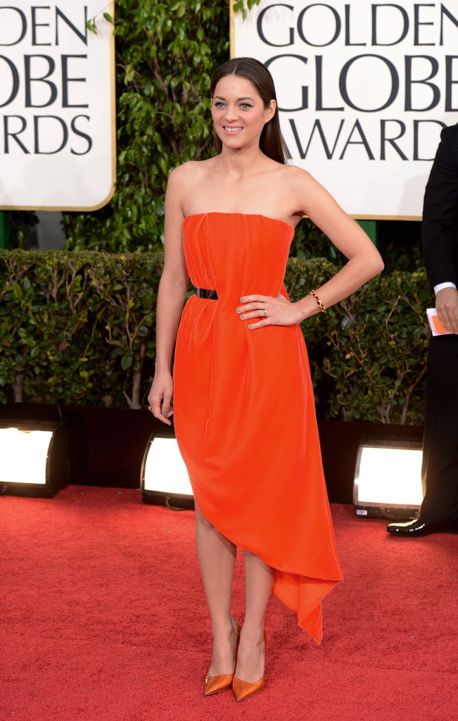 French film star Marion Cotillard was fire-engine bright in a custom Dior dress and coordinating pumps.