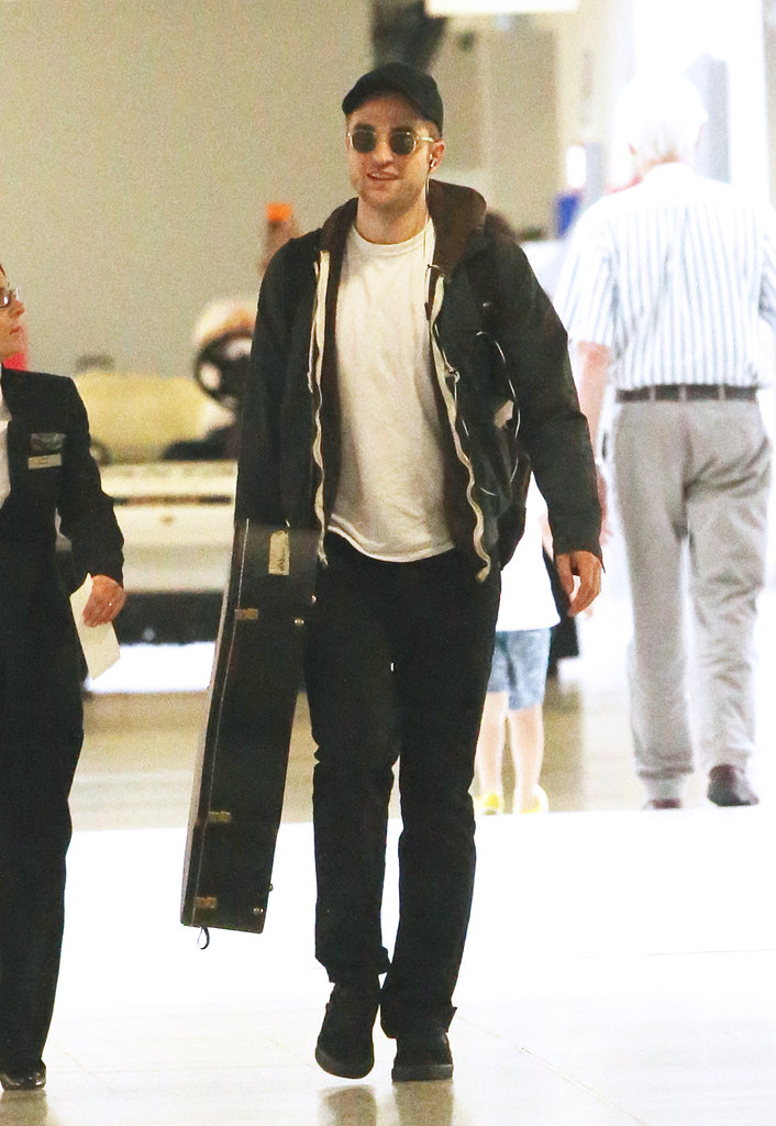 Sneaky! Robert Pattinson made a very secretive arrival in Australia on January 17 — he's here to shoot his new movie, The Rover.