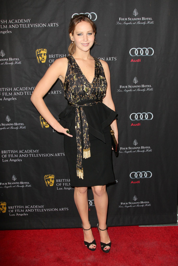 Wearing this black and gold Altuzarra Spring '13 number, Jennifer looks classy beyond her 22 years. The structured peplum and the busy print could be too much, but J.Law carries it well.