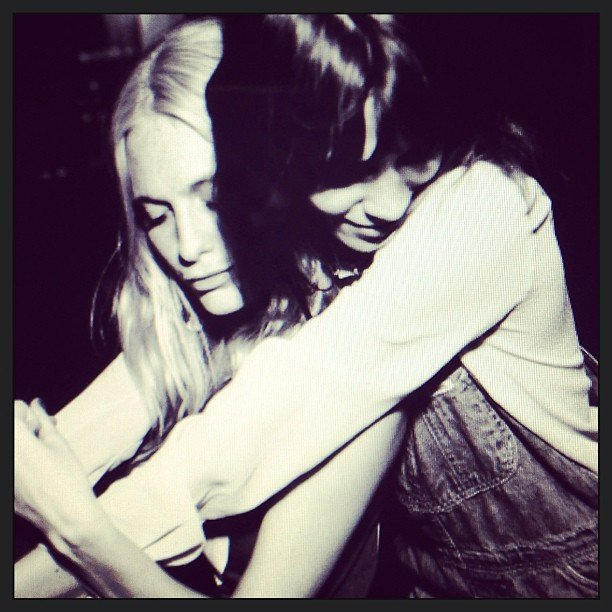 Poppy Delevingne and Alexa Chung snuggled up. So many style icons, so little time. Source: Instagram user poppydelevingne