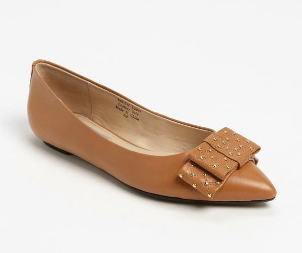 We're all about the mix of studs and bows, so these Classiques Entier camel bow flats ($130) are right up our alley.