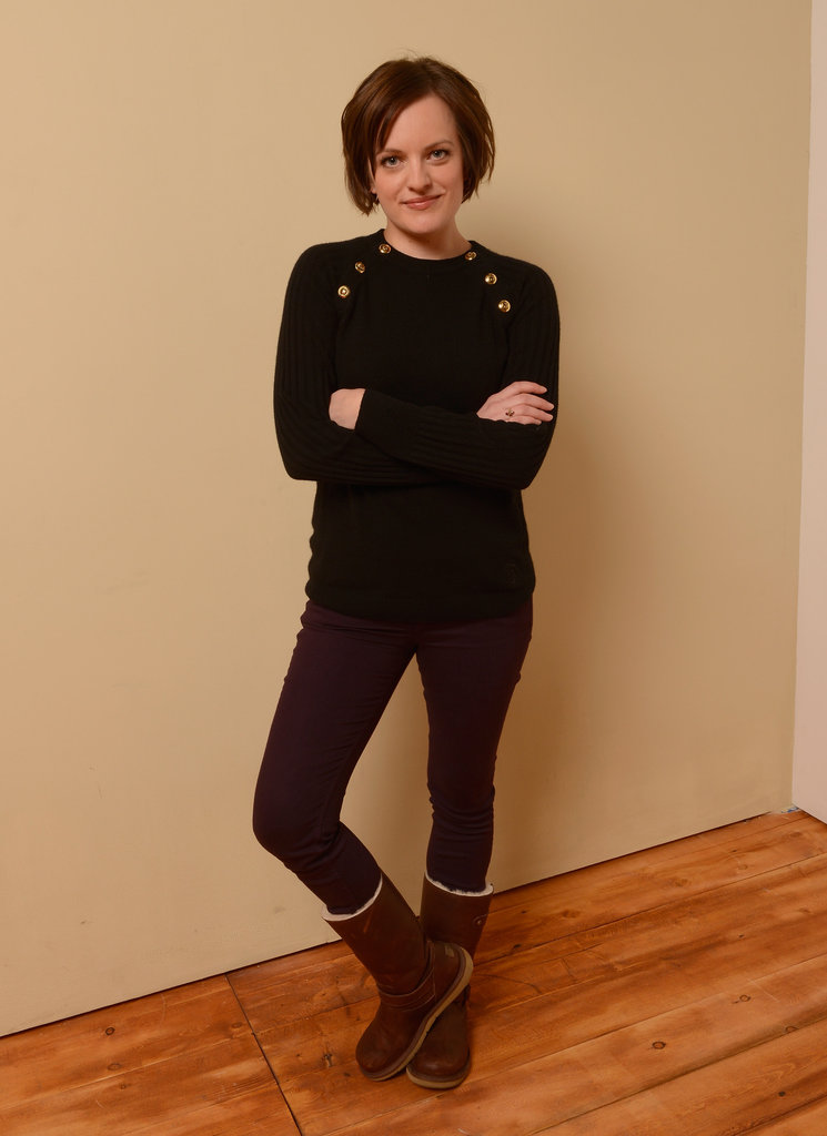 Elisabeth Moss was cute and cosy in a ribbed Tory Burch sweater, plum denim, and shearling boots.