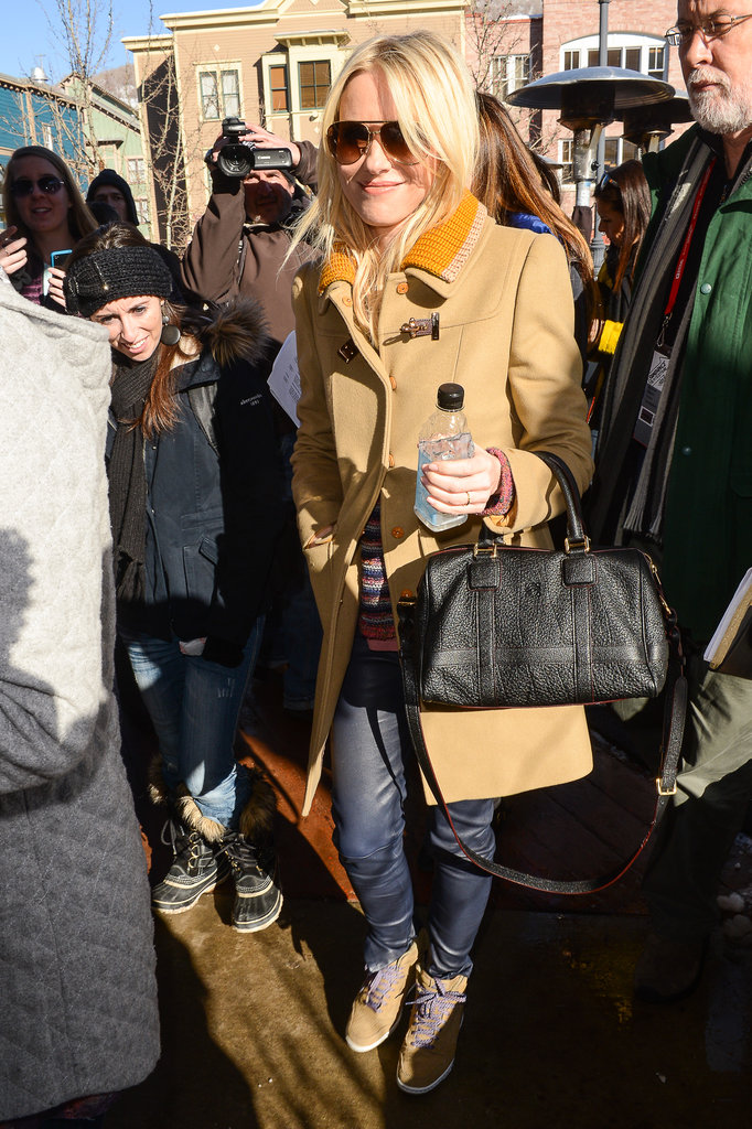 Naomi Watts paired her Fay coat with a black Loewe satchel, jeans, and sneakers for a polished, laid-back look.