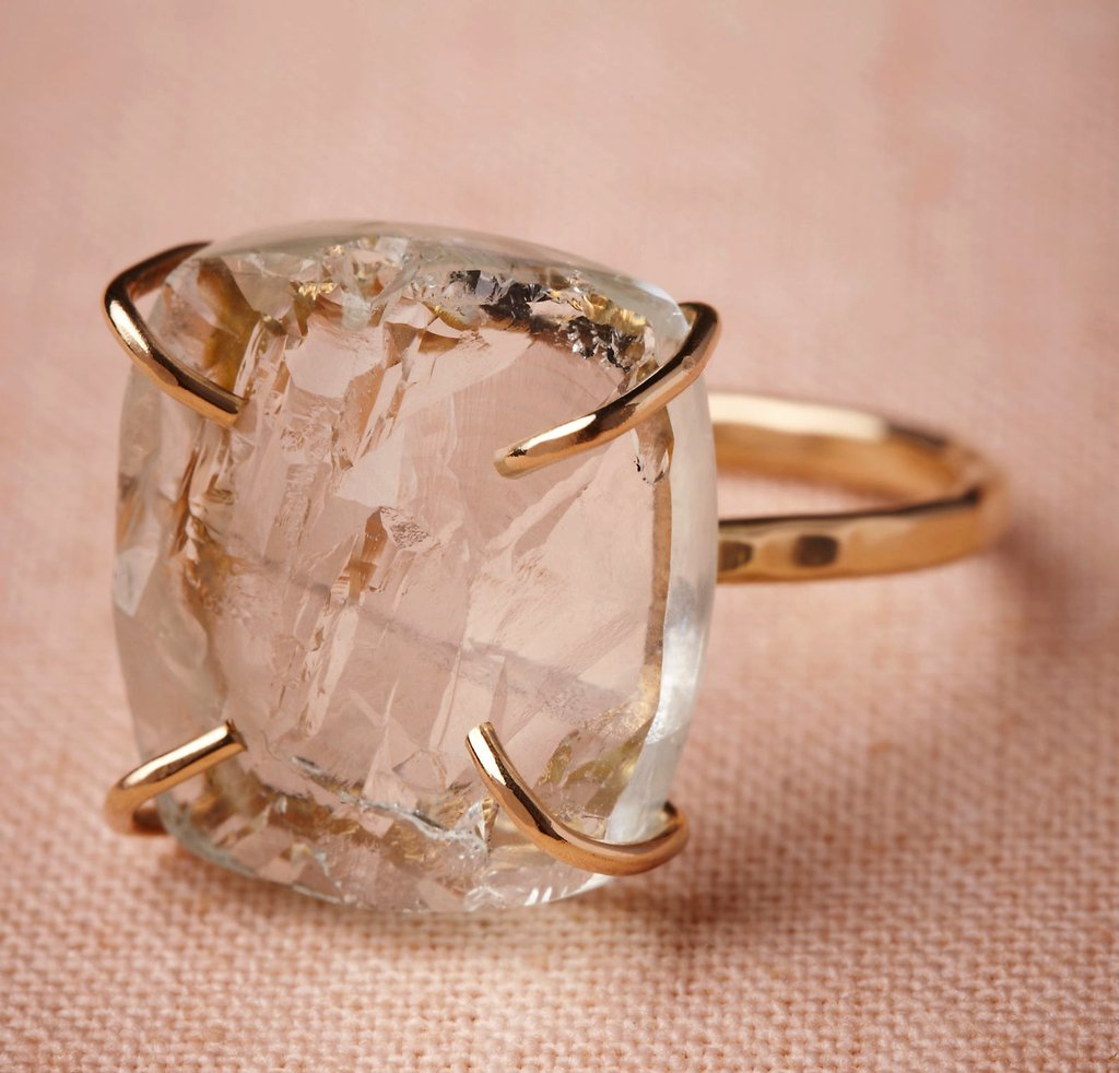 "Without bordering too much on the cocktail side of things, we're currently loving this Melissa Joy Manning for BHLDN Slice of Sky ring ($915), which, if you look closely, is actually set with aquamarine stone. You know what that means? This also qualifies as your ""something blue."""