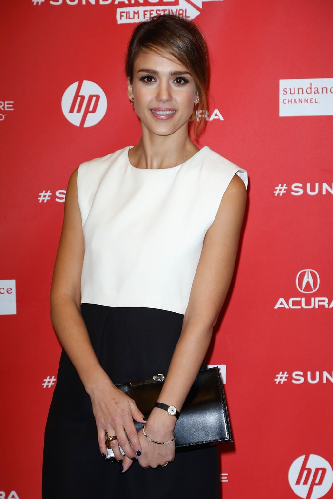 Jessica Alba finished off her look with gold jewels by Iwona Ludyga Design and a sleek black leather clutch.