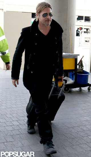 Brad Pitt wore an all black ensemble to travel out of LAX.