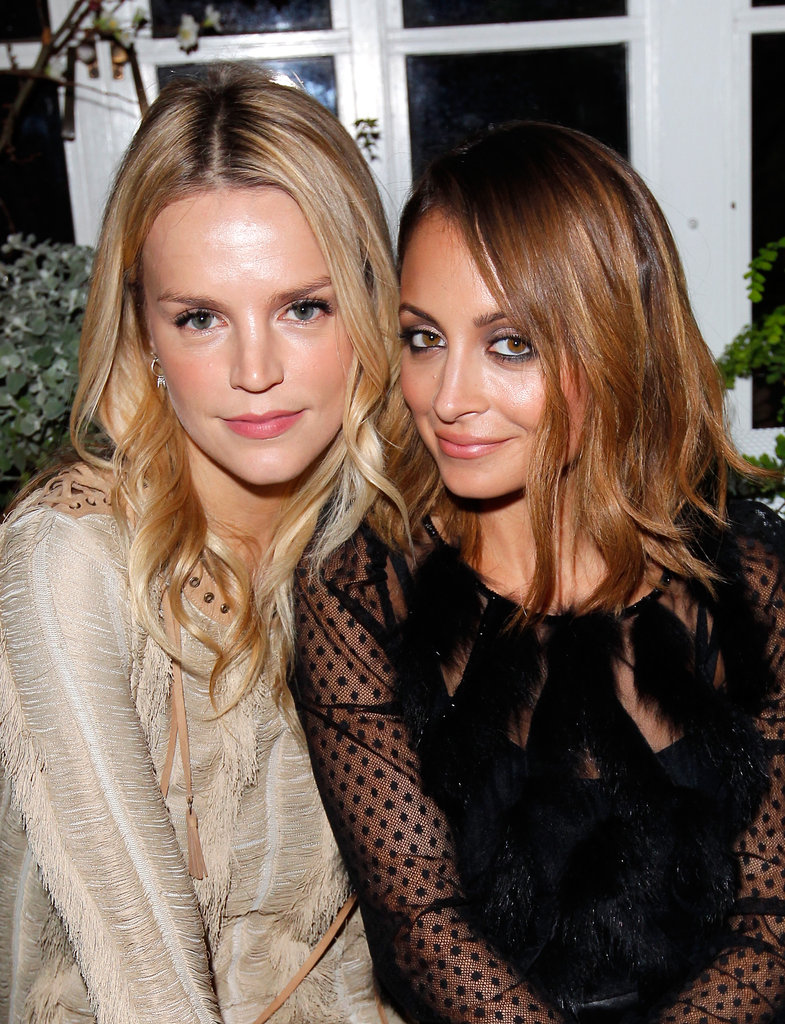 Nicole Richie buddied up with Kelly Sawyer Patricof at Ferragamo's Spring runway collection in LA.