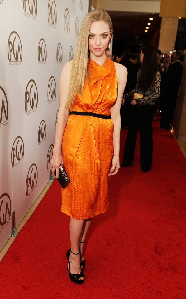 Amanda Seyfried added a jolt of color to the red carpet in an orange silk Roland Mouret dress, Jimmy Choo shoes, Cathy Waterman earrings, and a Judith Leiber clutch.