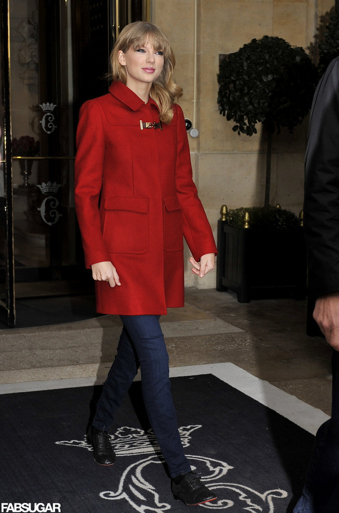 Taylor Swift incorporated her favorite color, red, into her Winter ensemble via a bright coat while exiting her hotel in Paris.