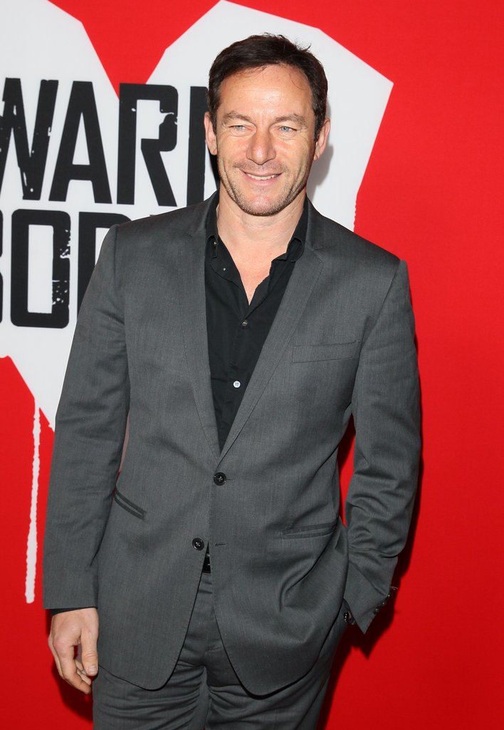 Jason Isaacs wore a grey suit and a black shirt to the premiere.