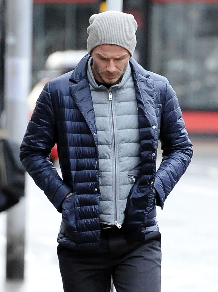 David Beckham wore layers for a stroll around London.