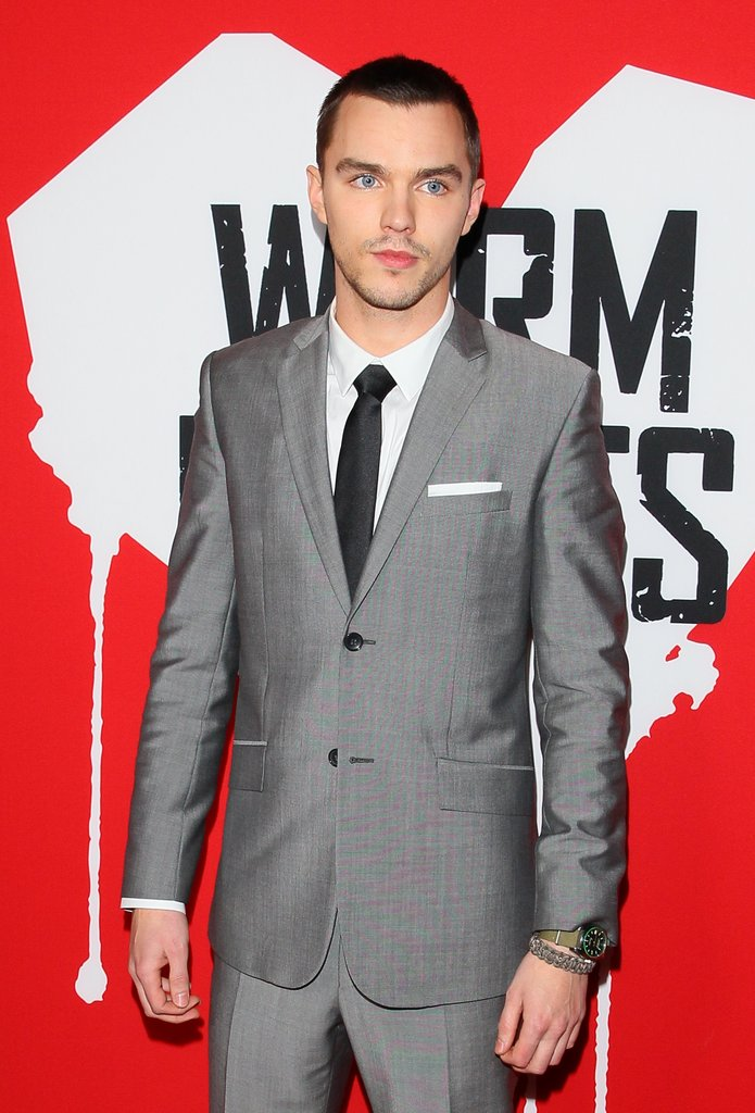 Nicholas Hoult wore a grey suit on the red carpet.