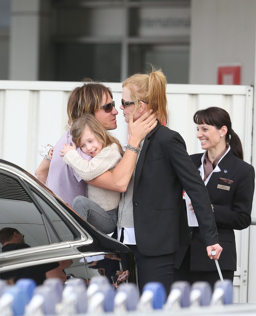 Keith and Nicole kissed upon reuniting at Sydney Airport.
