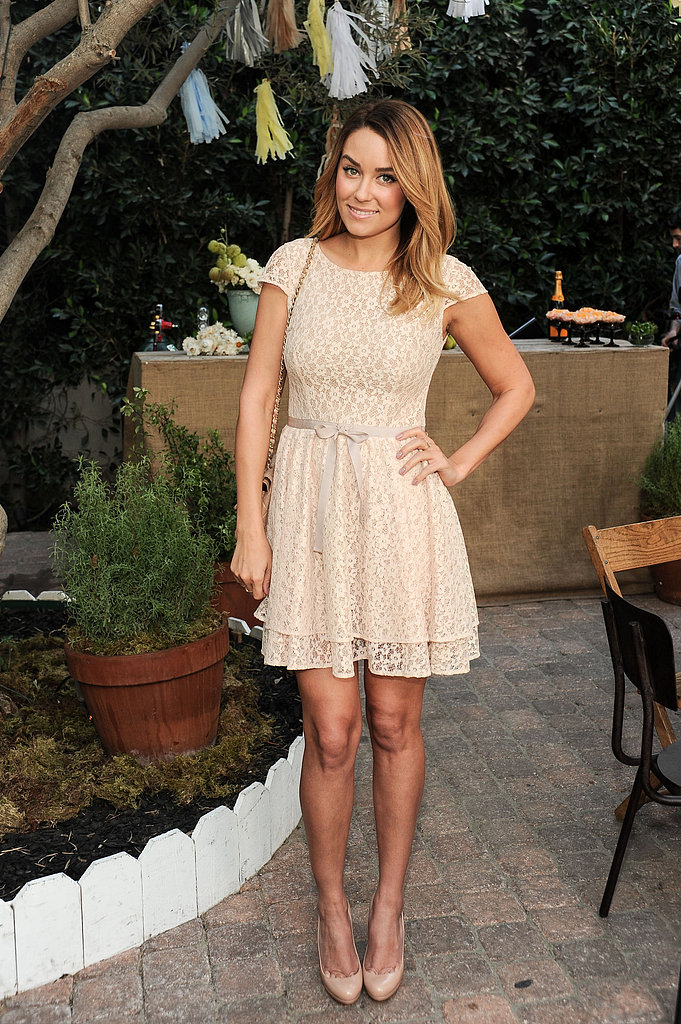 For a ShoeMint event in 2012, Lauren wore a cream-coloured lace dress with her beloved nude Christian Louboutins.