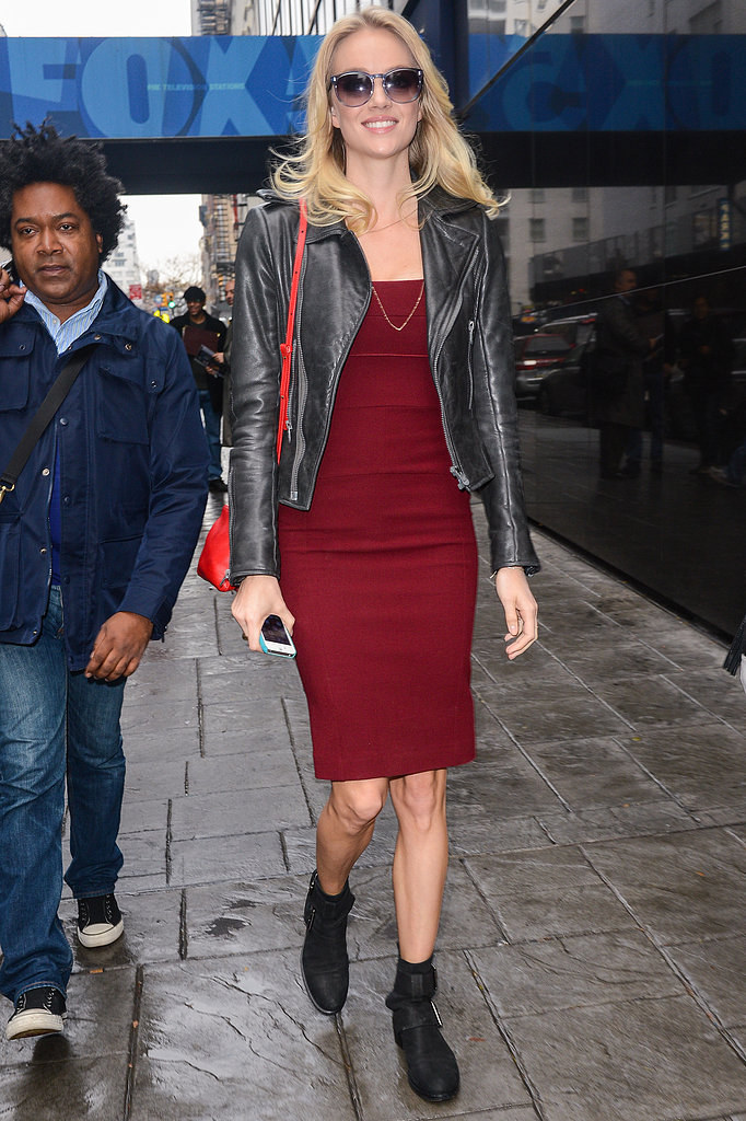 Lindsay Ellingson toned down her body-hugging red dress with a black leather biker jacket and flat ankle boots in NYC. You can do the same with your sexy dresses.