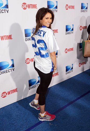 Nina Dobrev showed off her jersey at the 7th Annual Celebrity Beach Bowl game on Saturday.