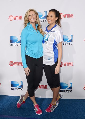 Erin Andrews and Chrissy Teigen smiled before the celebrity beach bowl game on Saturday.