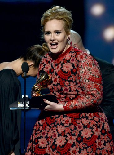 Adele, who won six Grammy Awards in 2012, accepted her Grammy for best pop solo performance in 2013 .