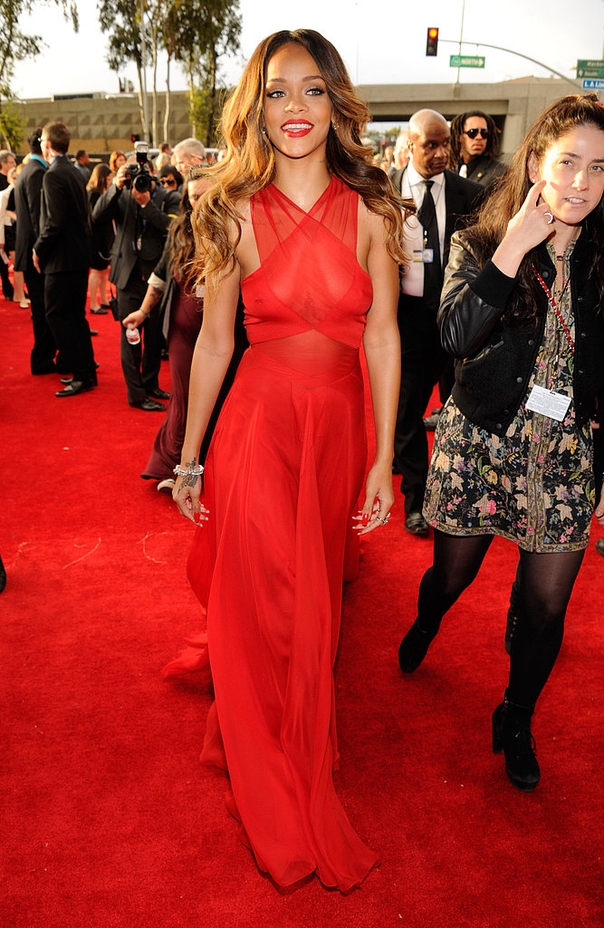 Rihanna arrived at the Grammys wearing a custom red Azzedine Alaïa gown.