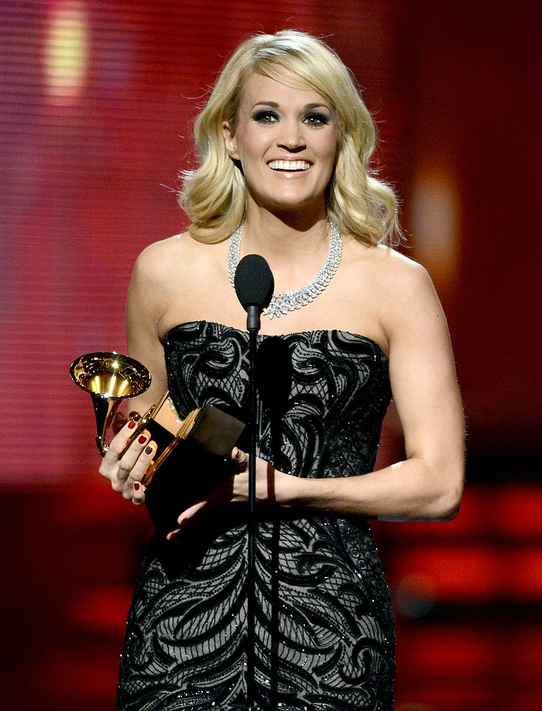 Carrie Underwood accepted her Grammy on stage.