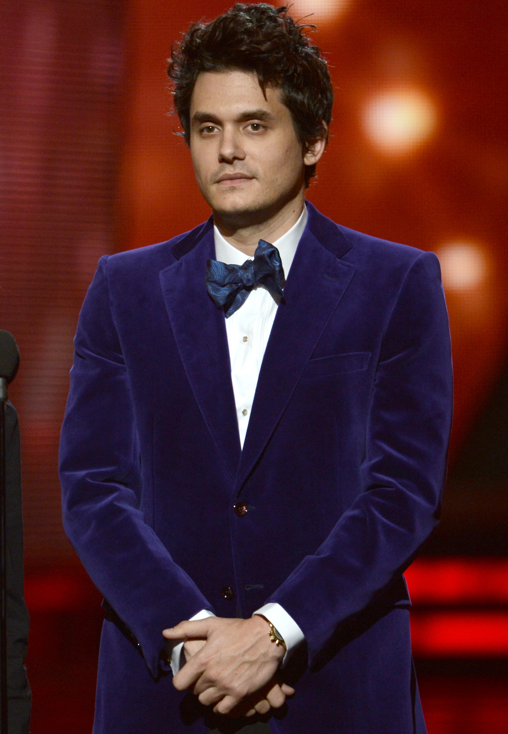 John Mayer wore a blue blazer.