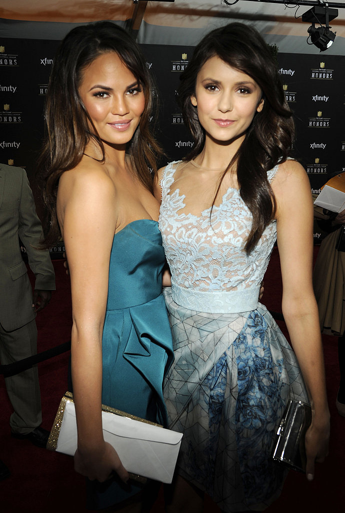 Chrissy Teigan and Nina Dobrev stopped for pictures at the NFL Honors ceremony Saturday evening in New Orleans.