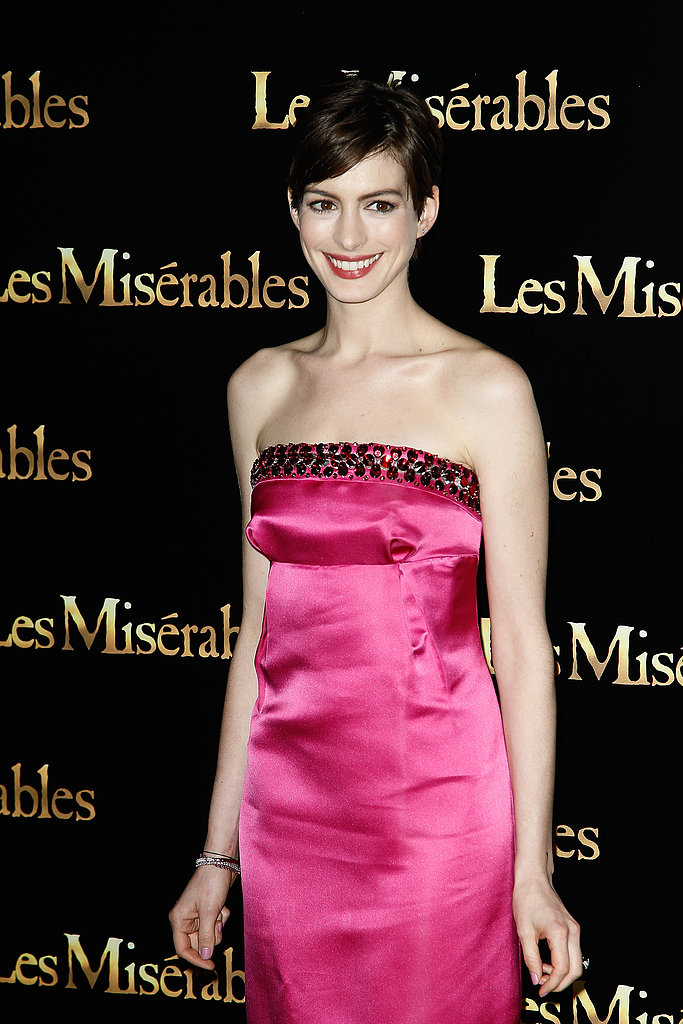 Anne Hathaway went strapless in Prada.