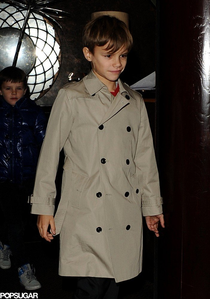 Romeo Beckham looked precious in his trench coat.