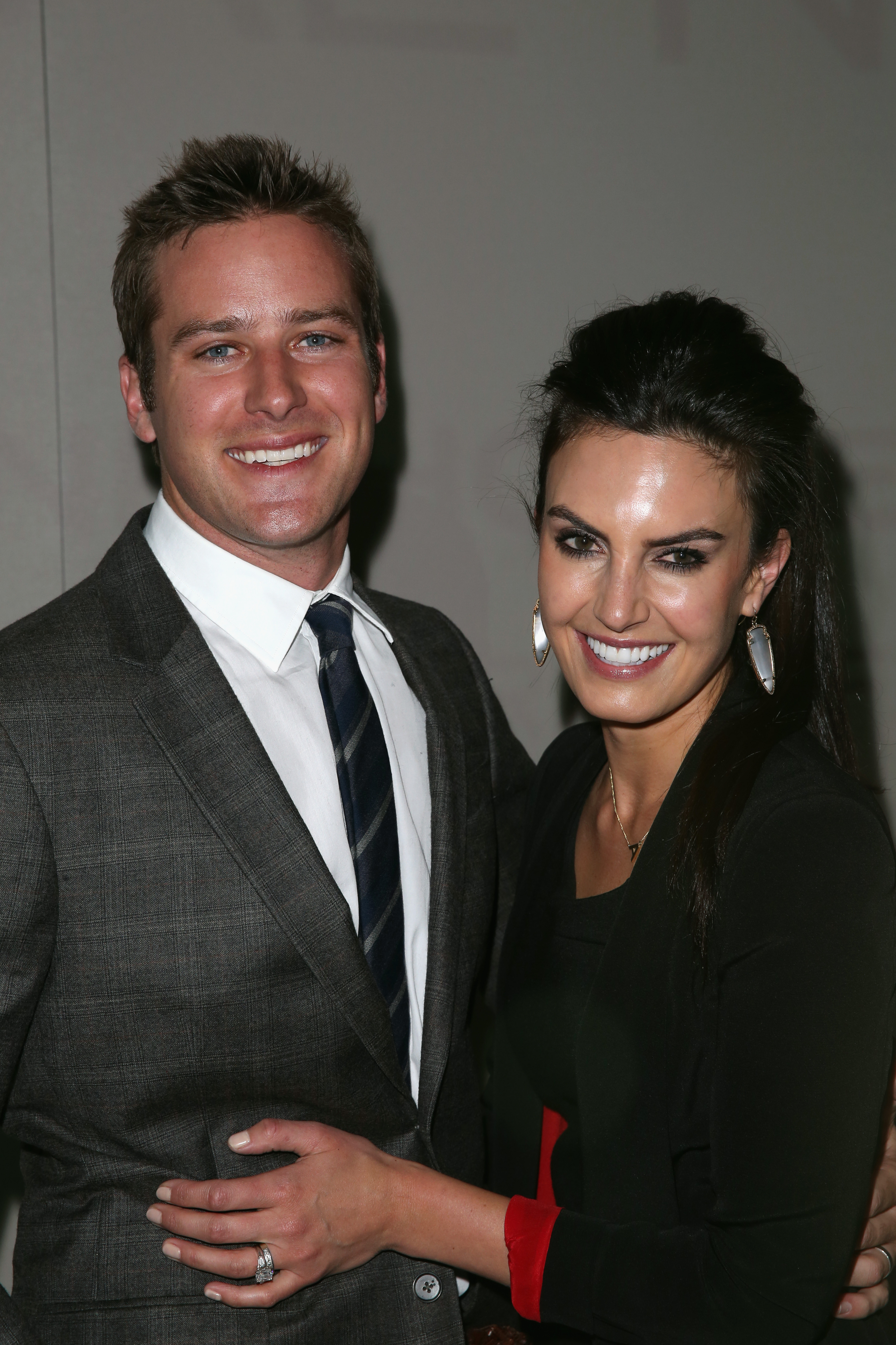 Armie Hammer and his wife, Elizabeth Chambers, smiled big backstage at the Kenneth Cole show on Thursday.