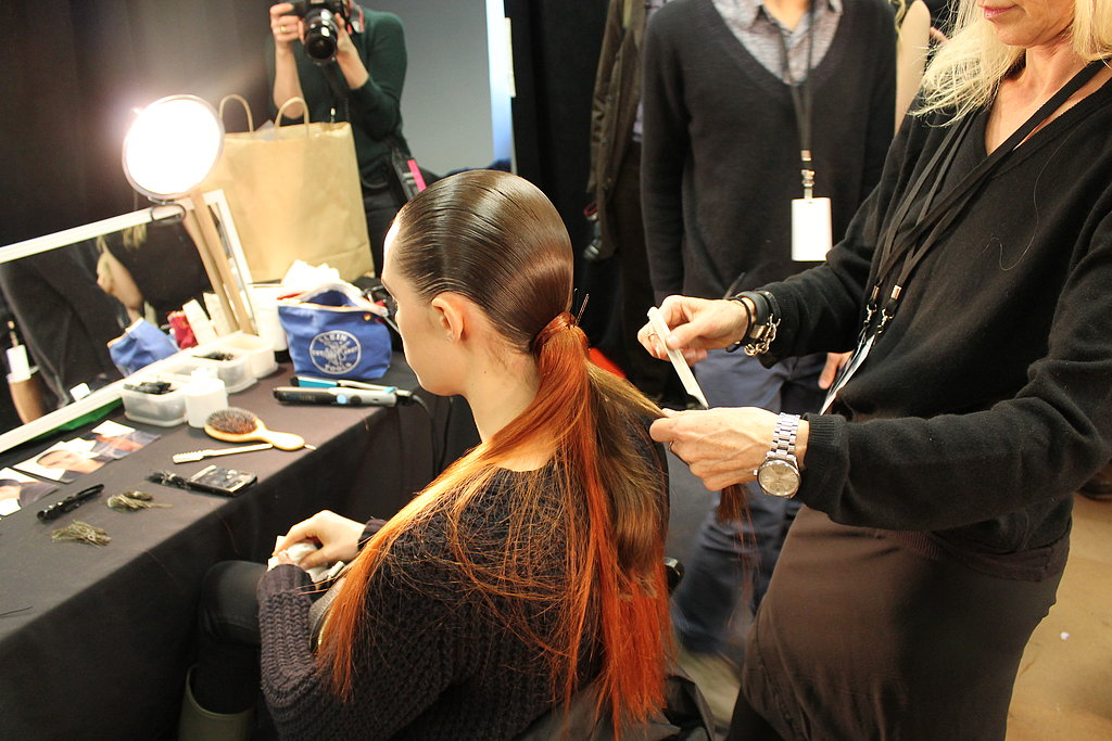 """""""The ponytail is simple and dramatic,"""" Guido said. """"There's no reference to any period, but it is slightly futuristic."""" The swatch of whiskey-tinted hair added to the surrealism of the look."""