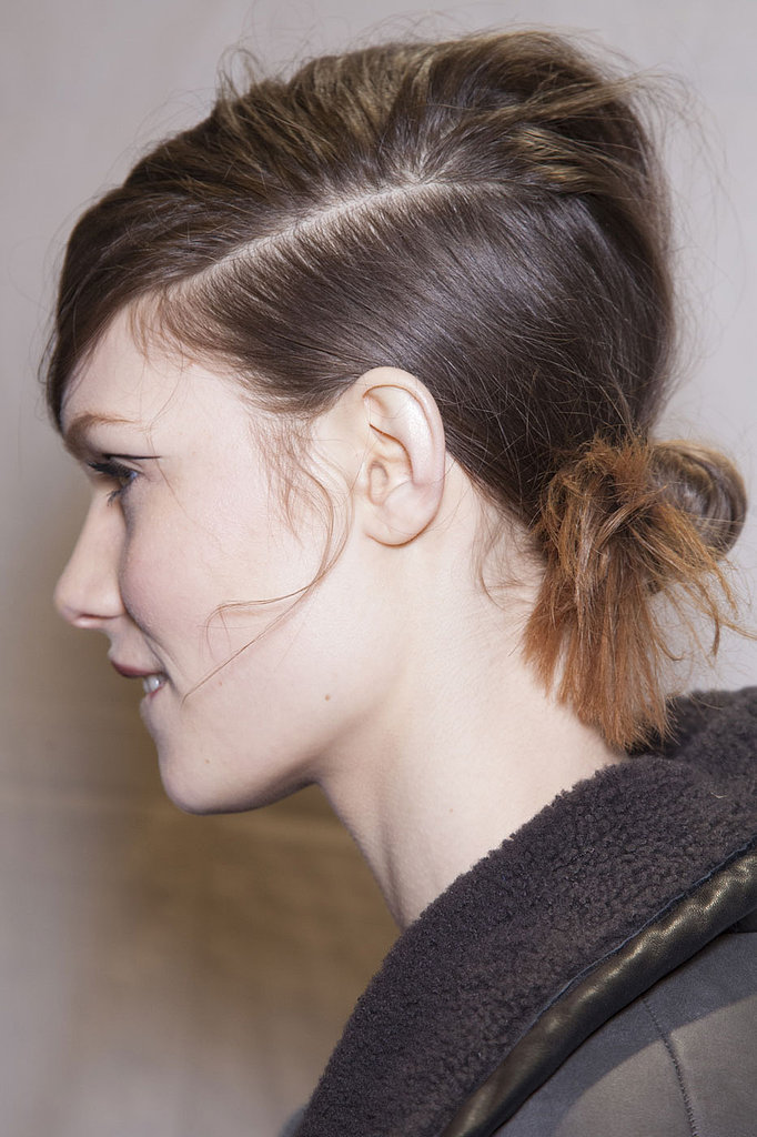 """He used the Redken Powder Refresh (inquire for pricing) dry shampoo after a rough blow-dry to take the shine out of the hair for a bedraggled appearance. """"You have to put product in to make it look flat, matte, boyish,"""" he said. Then, stylists twisted a low ponytail into a chignon, leaving ends spiky and frayed."""