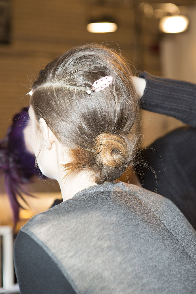 """For hair, Redken Creative Consultant Guido also took his cues from the '60s, the centerpiece of the look being a deep side part à la Edie Sedgwick. """"I like to soften everything by pulling a little bit in the crown so it's a little '60s, but not too exaggerated,"""" he explained. """"The whole thing is very soft and easy. The real star is the clean part, so the rest can be disheveled."""""""