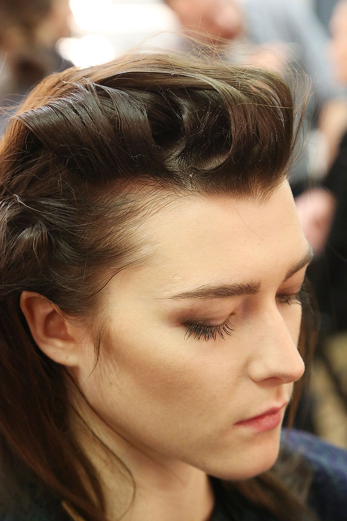 The key to creating the structured bouffant is a small flat iron to get the blown-back shape. Ryan used both mousse and gel from TRESemmé to create the sharp, square front.