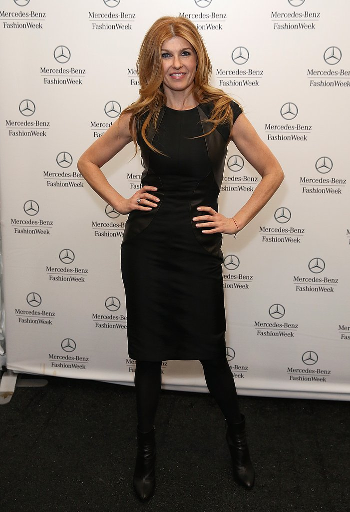 Nashville star Connie Britton doubled down on black working a fitted sheath, leg-lengthening tights, and leather ankle boots backstage at Monique Lhuillier.
