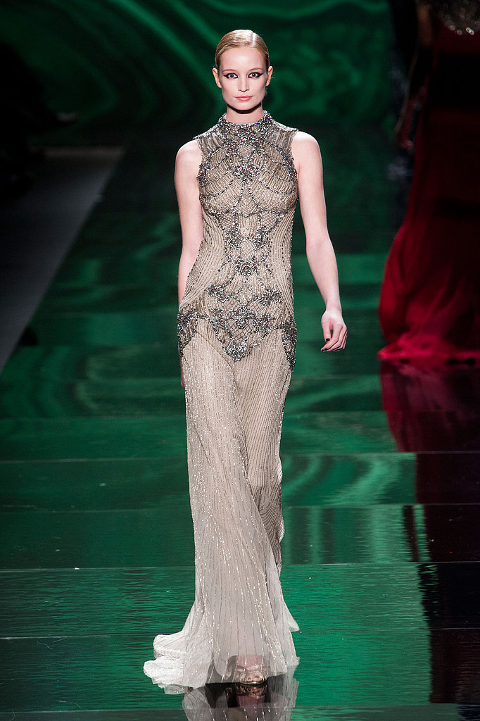This pale gray, artfully beaded Monique Lhuillier Fall 2013 gown would be a great look for nominee Anne Hathaway.