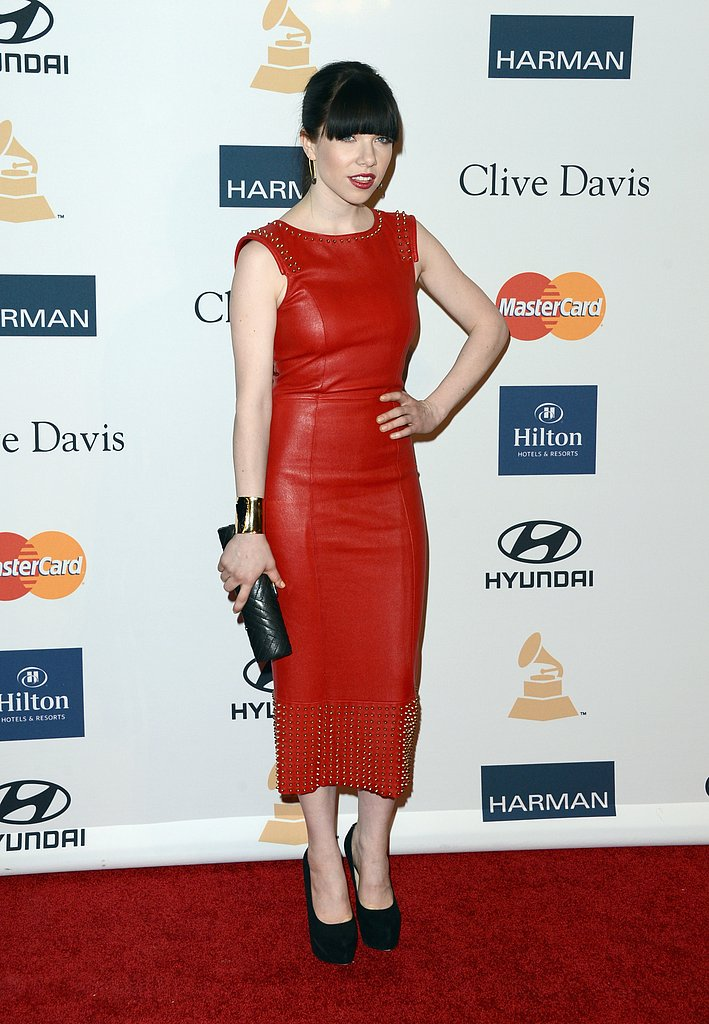 Carly Rae Jepsen went edgy in a studded red-leather sheath and black platform pumps. She accessorized with a quilted leather clutch, wide gold cuff, and quirky safety-pin earrings.