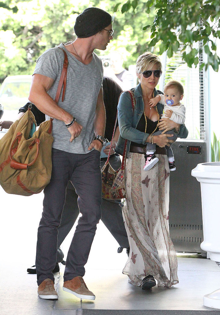 Chris Hemsworth check into a hotel with wife Elsa Pataky and daughter India.