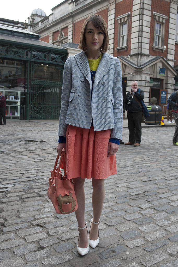 An adorable boy-meets-girl mix made all the sweeter with a pink skirt and white pumps.
