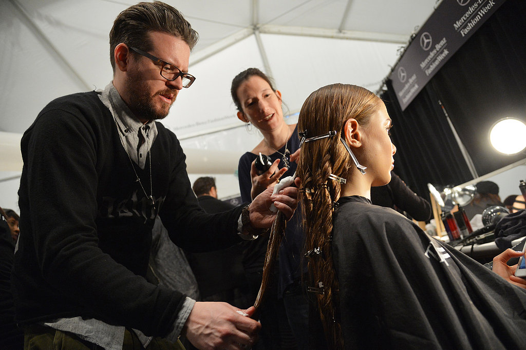 To create natural-looking waves without heat-styling, Nick Irwin for Catwalk by TIGI twisted sections of hair with Curlesque Strong Mousse and secured with clips to set the style. Once it was completely dry (about 20 minutes), he separated each section with his fingers. If you try this at home, the key to cutting frizz is to have a soft touch to keep it from getting too frizzy.