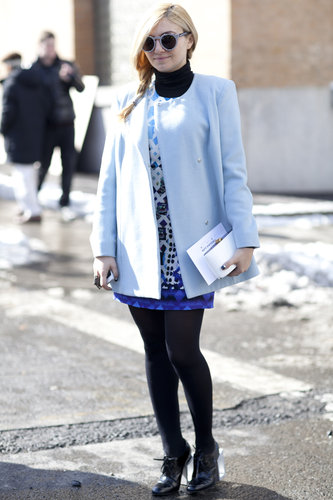 A mod moment with a sweet coat and bold print — even on her shades.